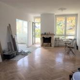 Top 11 Wohnzimmer mit halboffener Küche im Umbau